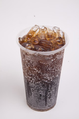 Fototapeta Cola with ice in take away cup isolated on white background