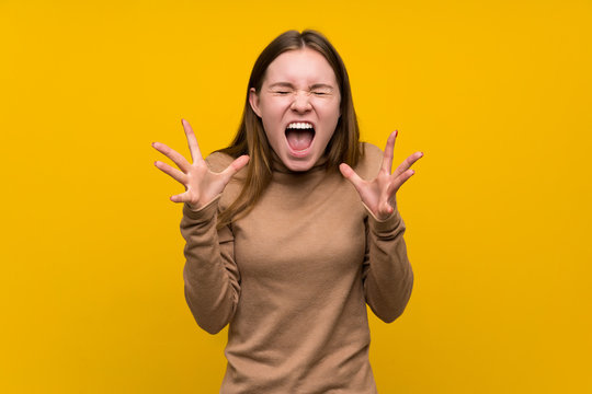Young woman over colorful background unhappy and frustrated with something