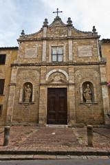 Entrance to small church chiesa di San Pietro in Selci near Fortezza Medicea in Voltera, Tuscany, Italy