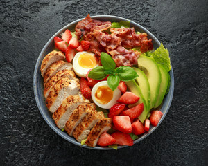 Chicken Cobb salad with strawberries, bacon, avocado and boiled eggs