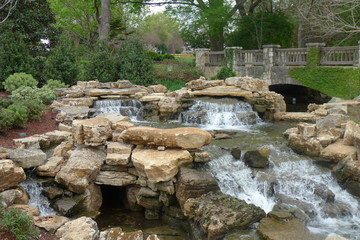 Stone Bridge and Water and Rocks in Dallas Arboretum and Botanical Garden