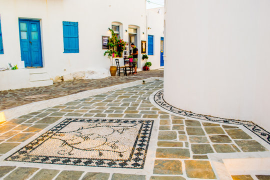 Street view of Plaka village with paved alleys and traditional cycladic architecture in Milos island in Cyclades, Greece