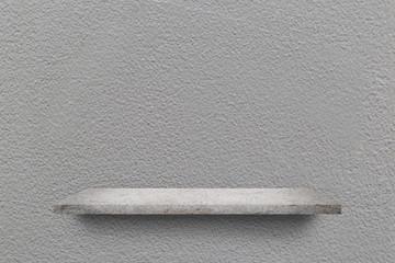 Empty shelf over grey concrete wall background