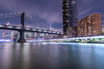 Night view on Financial district and One Manhattan Square from east river with long exposure