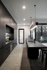 Dark styled kitchen in contemporary luxury home