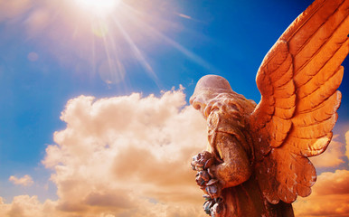 Fototapete - Ancient statue of guardian angel in sunlight as a symbol of strength, truth and faith.