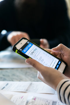 Taxes: Woman Uses Phone App To Track Purchase Receipts