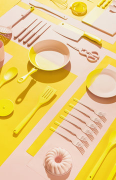 Pink and yellow kitchen objects/utensil.