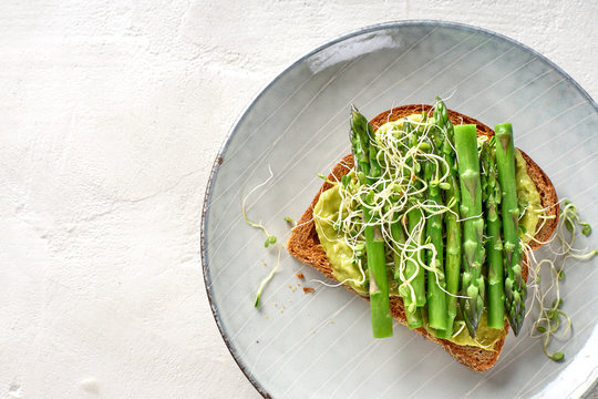 Green Avocado Asparagus and Sprouts Breakfast Toast