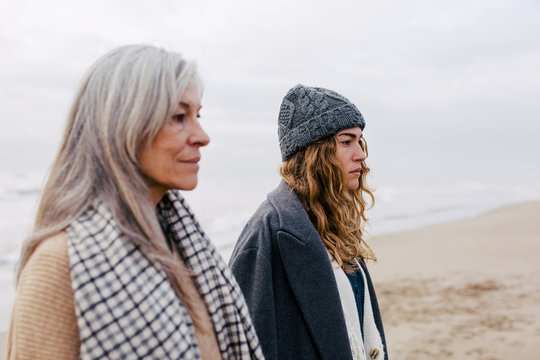 Portrait of senior woman and her daughter on the beach.