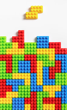 Colorful tetrominos made of colorful plastic building bricks