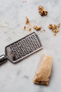 Parmesan and walnuts on marble background