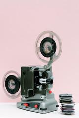 Vintage cinema projector and movie reels