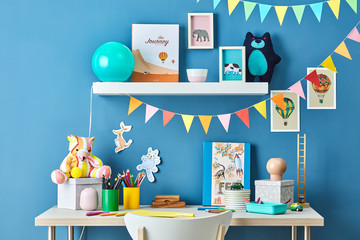 Kid's study with garlands, pictures and toys.