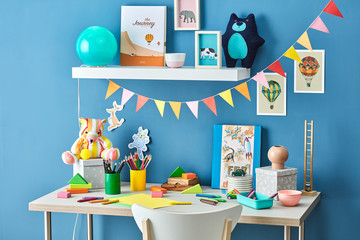 Bright kid's workplace decorated with handmade garlands.