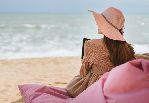 Woman relax from working at the beach in holidays