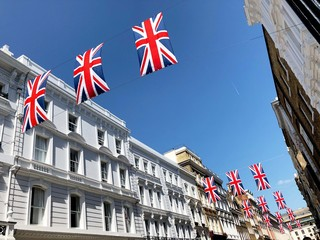Street in London, festooned with Union Jack flags.