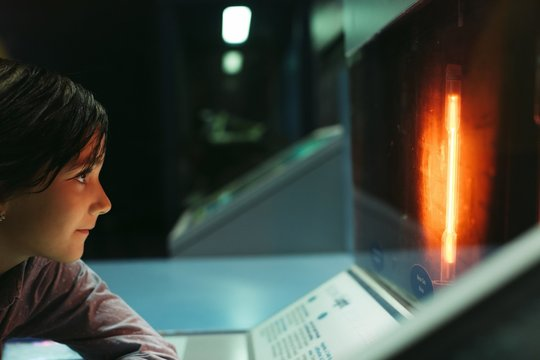 Little girl learning on science tour