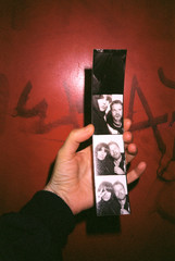 Photobooth strip of a young couple in hand