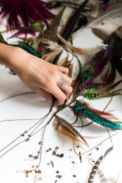Close up of woman making  handmade earrings
