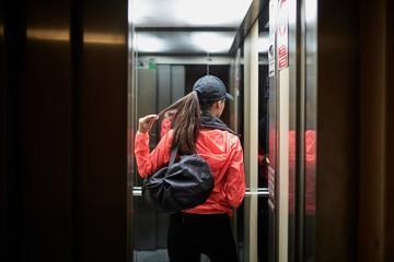 Sportswoman Standing In Elevator