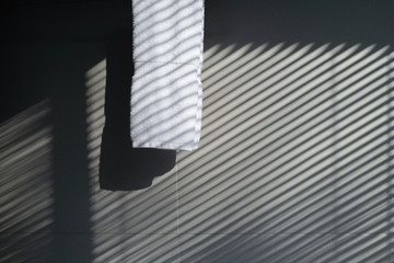 close-up of white towel and wall