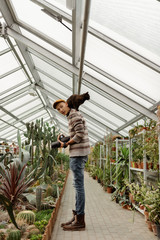 Photographer with cat in hothouse