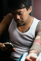 Portrait of asian man in studio tattoo