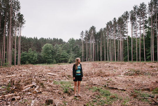 Woman Standing in Forest Clearcutting