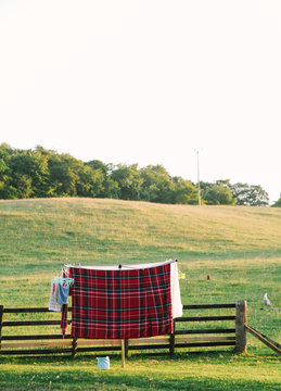 plaid sheets hang on clothesline to dry