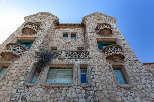 Modernist style building, Can Bou or Casa de Pedra (Stone house) designed by  Salvador Valeri. El Papiol, Catalonia, Spain.