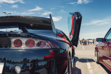 Serial cars with tuning and improved engines at open air exhibition
