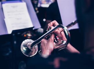 Trumpet player closeup concert music background