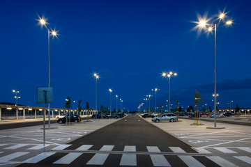 big modern empty parking area with LED street lights at night Fototapete