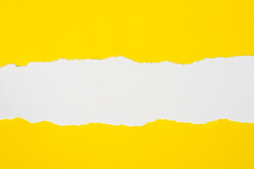 pieces of yellow paper on white background with copy space