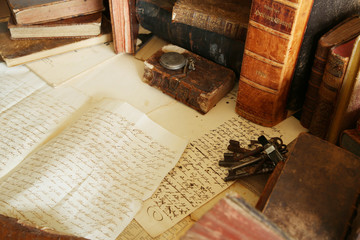 antique desk; workspace with old books and handwriting Fototapete