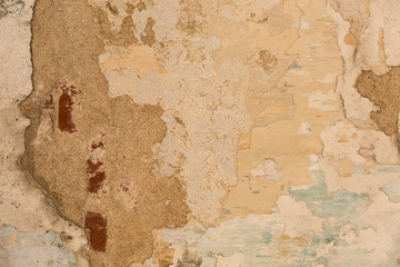 Spoed Foto op Canvas Wereldkaart old shabby damaged plaster on the walls of houses close-up
