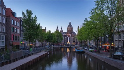 Wall Mural - Amsterdam city skyline day to night time lapse with Church of Saint Nicholas landmark in Amsterdam city, Netherlands