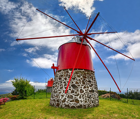 Old windmill near Conceicao (Faial, Azores) with volcano Pico in background