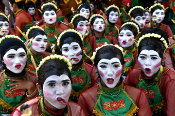Dancers reacts to camera before they perform a Thengul dance during a festival in Bojonegoro, East Java province,
