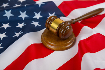Judge gavel on the background of the flag united states of America. symbol for jurisdiction. US