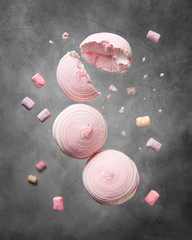 Soaring pink zephyr and marshmallow, levitation food, sweet dessert, flying candy