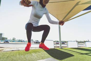 Arabic woman runner, making some urban running