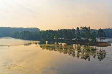 Panoramic scene of sunrise over lake in summer