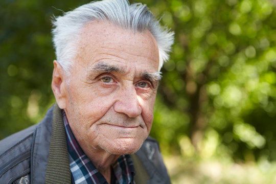 Elderly poor man thinks about life
