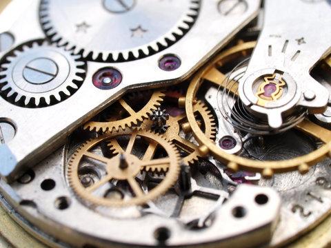 close up macro pic of vintage watch mechanism gears