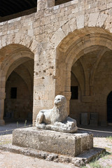Rhodes Old City - Archaeological museum, old Hospital of the Knights of Saint John. Main courtyard and lion statue. Dodecanese Islands, Greece