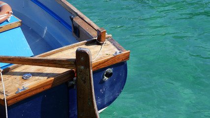 Sections of a Cornish wooden ferry boat in sunshine