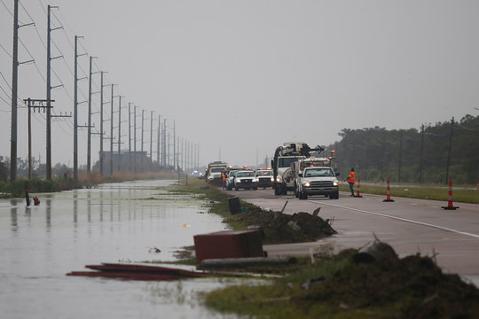 Crews clear debris from Highway 23 during Hurricane Barry in Plaquemines Parish