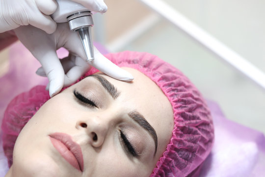 Girl with removal tattoo laser at beauty salon